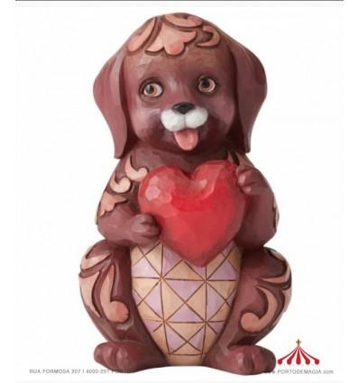 Cachorrinho segura coração com amor