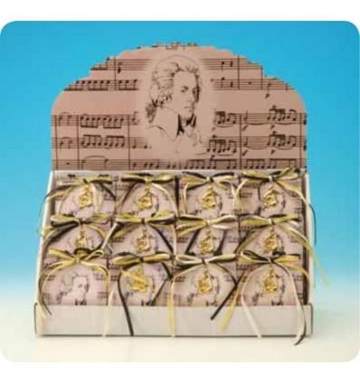 """Saco prenda, com contexto e claves douradas de Mozart, com a melodia """"Eine kleine Nachtmusik"""""""