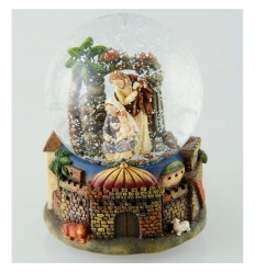 Crib scene with palm trees in a snow globe