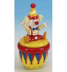 """O palhaço em madeira gira ao som da melodia """"Send in the Clowns"""""""