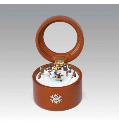 Caixa redonda em madeira com tampa em vidro e uma cena com patinadores